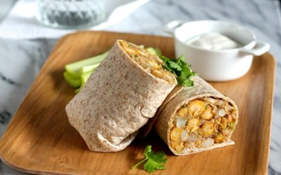 Cauliflower, Quinoa, and Chickpea Wraps, with Spicy Dairy-Free Sauce.